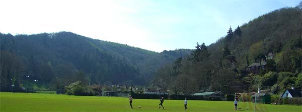 View towards Hawkcombe woods with footy game below The Cleeve, Porlock, Exmoor.